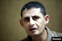 Saad Khalaf Ali, one of the 69 hostages rescued from an Islamic State prison in a joint raid by U.S. and Kurdish special forces, speaks during an interview with Reuters in Irbil, Iraq, Oct. 29, 2015.