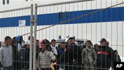 Would-be migrants believed to be from Tunisia at the port of the Sicilian island of Lampedusa, February 11, 2011