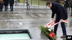 Polish Prime Minister Mateusz Morawiecki lays a wreath as he visits the Ulma Family Museum of Poles Who Saved Jews during WWII, in Markowa, Poland, Feb. 2, 2018.