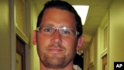 This undated image provided by the FBI shows Ryan Kelly Chamberlain, II, who is being sought by the FBI.