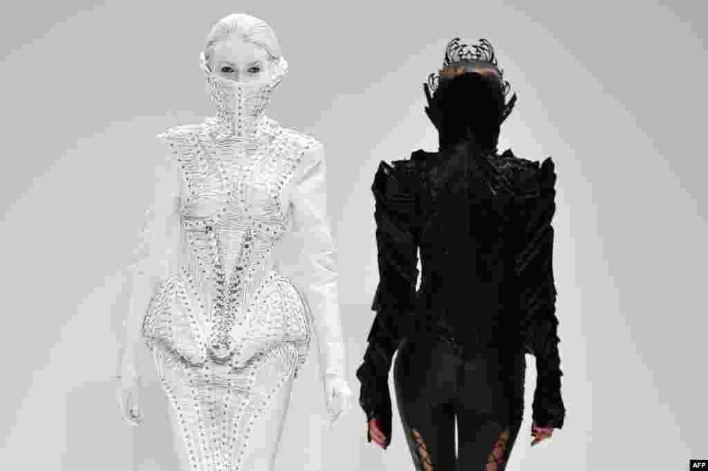 Models present creations of Serbian designer Marko Mitanovski during the 2015 Autumn/Winter London Fashion Week.