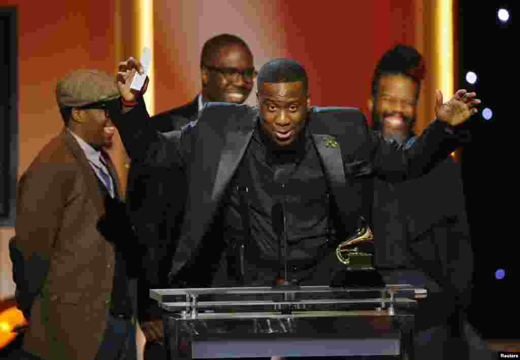 "The Robert Glasper Experiment accept their award for best R&B Album for their album ""Black Radio"" at the 55th annual Grammy Awards in Los Angeles, California, Feb. 10, 2013."