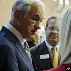 Texas Congressman Ron Paul greets supporters before he speaks at the Iowa Faith & Freedom Coalition's Presidential Forum at the Iowa State Fairgrounds in Des Moines, October 22, 2011