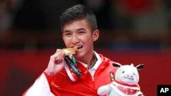 Rifki Ardiansya mempersembahkan emas ke-11 bagi kontingen Indonesia dari cabang karate pada Asian Games 2018.