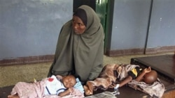Malnourished children from southern Somalia on a bed at Bandar hospital in Mogadishu