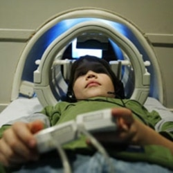 A 9-year-old boy with dyslexia in an MRI machine in 2004. Scientists now want to know whether brain images can identify younger children who might develop future reading problems.