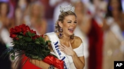 Miss New York Mallory Hytes Hagan reacts as she is crowned Miss America 2013, January 12, 2013, in Las Vegas.