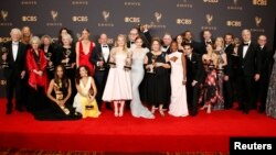 69th Primetime Emmy Awards – Photo Room – Los Angeles, California, 17 Sept. 2017 - The Handmaid's Tale cast and crew pose with their Emmys.