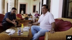 Former New Mexico Gov. Bill Richardson, right, sits in the Nacional Hotel after a press conference in Havana, Tuesday Sept. 13, 2011