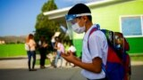 A student wearing a protective mask enters a school, as in-person classes return after over a year of online lessons as the coronavirus disease (COVID-19) outbreak continues, in Ciudad Juarez, Mexico August 30, 2021. (REUTERS/Jose Luis Gonzalez)