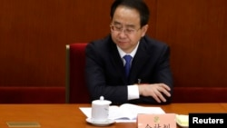 FILE - Ling Jihua pauses while attending the opening ceremony of the Chinese People's Political Consultative Conference (CPPCC) at the Great Hall of the People in Beijing, March 3, 2013.
