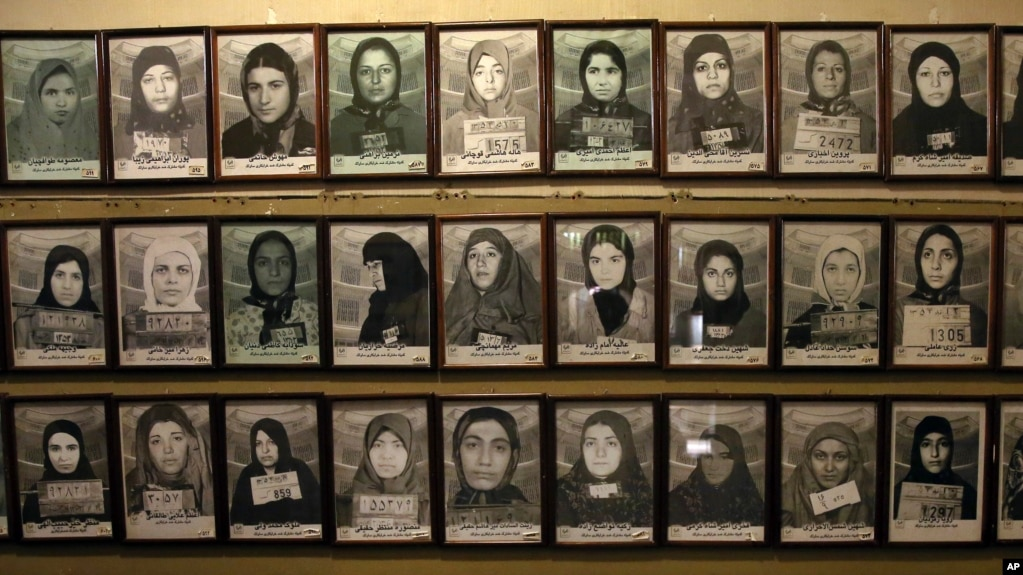Mug shots of former prisoners hang on the wall at a former prison run by the pre-revolution intelligence service, Savak, now a museum, in downtown Tehran, Jan. 7, 2019.