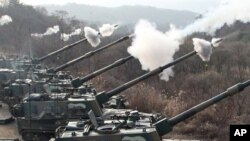 South Korean Army's K-9 self-propelled gun fire live rounds during the largest joint air and ground military exercises on the Seungjin Fire Training Field in mountainous Pocheon, 20 miles (30 kilometers) from the Koreas' heavily fortified border, South Ko