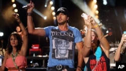 Luke Bryan performs at the 2013 CMA Music Festival at LP Field on June 6, 2013 in Nashville Tennessee.