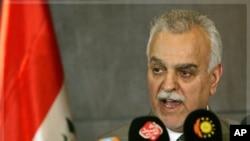 伊拉克副總統哈希米星期二在伊拉克北部的阿比爾舉行的記者會上講話