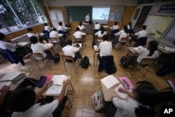 Students attend a Japanese language class at a Tokyo Korean high school, Sept. 26, 2017.