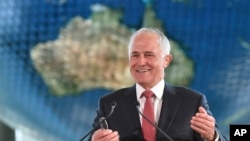 FILE - Australian Prime Minister Malcolm Turnbull delivers a speech in Tokyo, Japan. Turnbull, a former online entrepreneur, said hacking costs his country around $780 million per year.