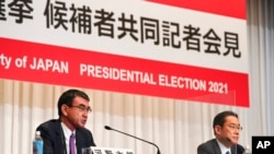 Taro Kono, left, state minister in charge of administrative reform, speaks during a joint news conference as Fumio Kishida, former foreign minister, listens in Tokyo, Sept. 17, 2021.