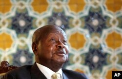 FILE - Ugandan President Yoweri Museveni speaks to reporters at the Akasaka Palace state guesthouse in Tokyo, Sept. 12, 2015.