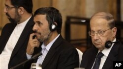 From right, Lebanese Christian leader Michel Aoun, Iranian President Mahmoud Ahmadinejad and Iranian ambassador to Lebanon Ghadanfar Rukun Abadi, listen during a meeting between Ahmadinejad and Lebanese politicians at a hotel in Beirut, Lebanon, Thursday,