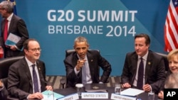FILE - President of France Francois Hollande, U.S. President Barack Obama, Britain's Prime Minister David Cameron and Germany's Chancellor Angela Merkel at the G20 leaders summit in Brisbane, Australia, Nov. 2014.
