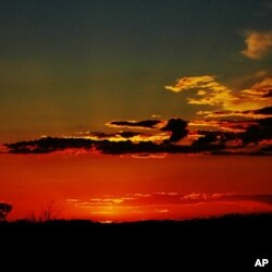 """New Mexico, """"The Land of Enchantment,"""" is famous for sunsets such as this one."""