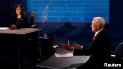 美国两大政党副总统候选人2020年10月7日晚首次直面辩论(路透社转发媒体联访照片)