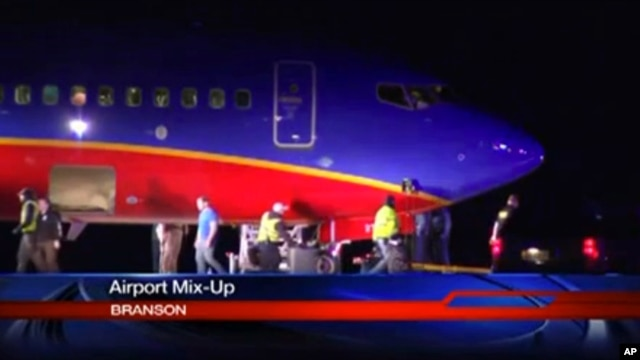 This frame grab provided by KSPR-TV shows a Southwest Airlines flight that was scheduled to arrive Jan. 12, 2014, at Branson Airport in southwest Missouri instead landed at an airport 7 miles north.