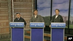 Three candidates for prime minister of the Tibetan government-in-exile in Northern India - Tenzin Tethong (l), Lobsang Sangay (c) and Tashi Wangdi (r) - face off in Washington for an internationally-televised debate, March 1, 2011