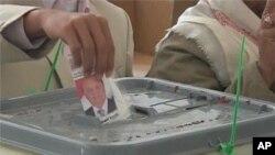Casting a ballot in Yemen.