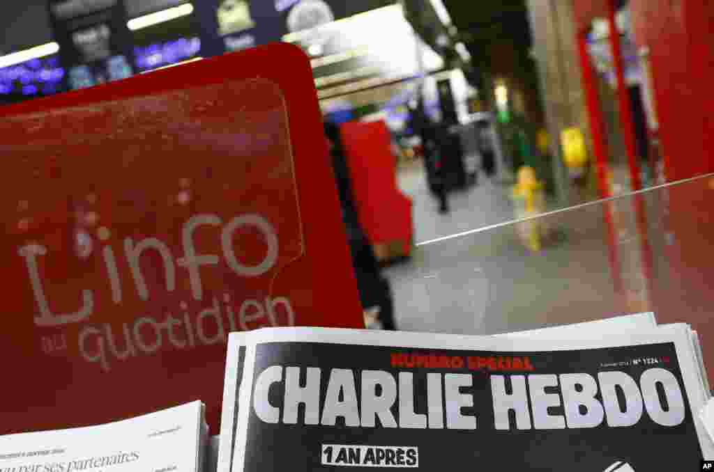 A special edition of the satirical newspaper Charlie Hebdo on a newsstand Wednesday, Jan. 6, 2016 at a train station in Paris.