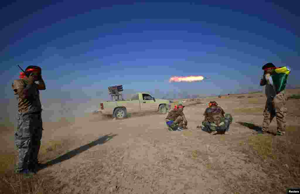 Shi'ite Popular Mobilization Forces (PMF) launch a rocket towards Islamic State militants on the outskirts of Tal Afar, Iraq.