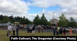 A gunman and a student are dead after an Oregon school shooting Tuesday morning. Parents were reunited with their children in a nearby supermarket parking lot in Troutdale, Oregon, June 10, 2014.