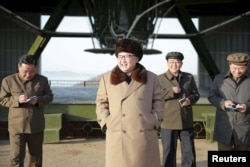 FILE - North Korea leader Kim Jong Un smiles as he visits Sohae Space Center in Cholsan County, North Pyongan province for the testing of a new engine for an intercontinental ballistic missile in this undated photo released by North Korea's Korean Central News Agency, April 9, 2016.