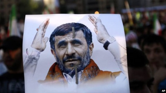 A Hezbollah supporter, holds a poster of Iranian President Mahmoud Ahmadinejad during a rally organized by Hezbollah for Ahmadinejad's visit to the southern suburb of Beirut, Lebanon, 13 Oct 2010