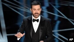 FILE - Host Jimmy Kimmel speaks at the Oscars at the Dolby Theatre in Los Angeles, Feb. 26, 2017.