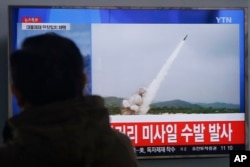 A man watches a TV news program showing file footage of missile launch conducted by North Korea, at Seoul Railway Station in Seoul, South Korea, March 3, 2016.