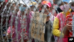 The workers are demanding a raise in their monthly salary of $160 US dollars, file photo. (AP Photo/Heng Sinith)
