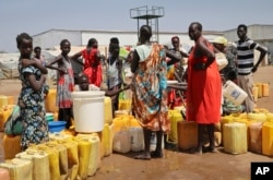 FILE - Residents of a camp for the internally displaced line up to get water from a borehole, on the outskirts of Juba, South Sudan, Jan. 22, 2019.