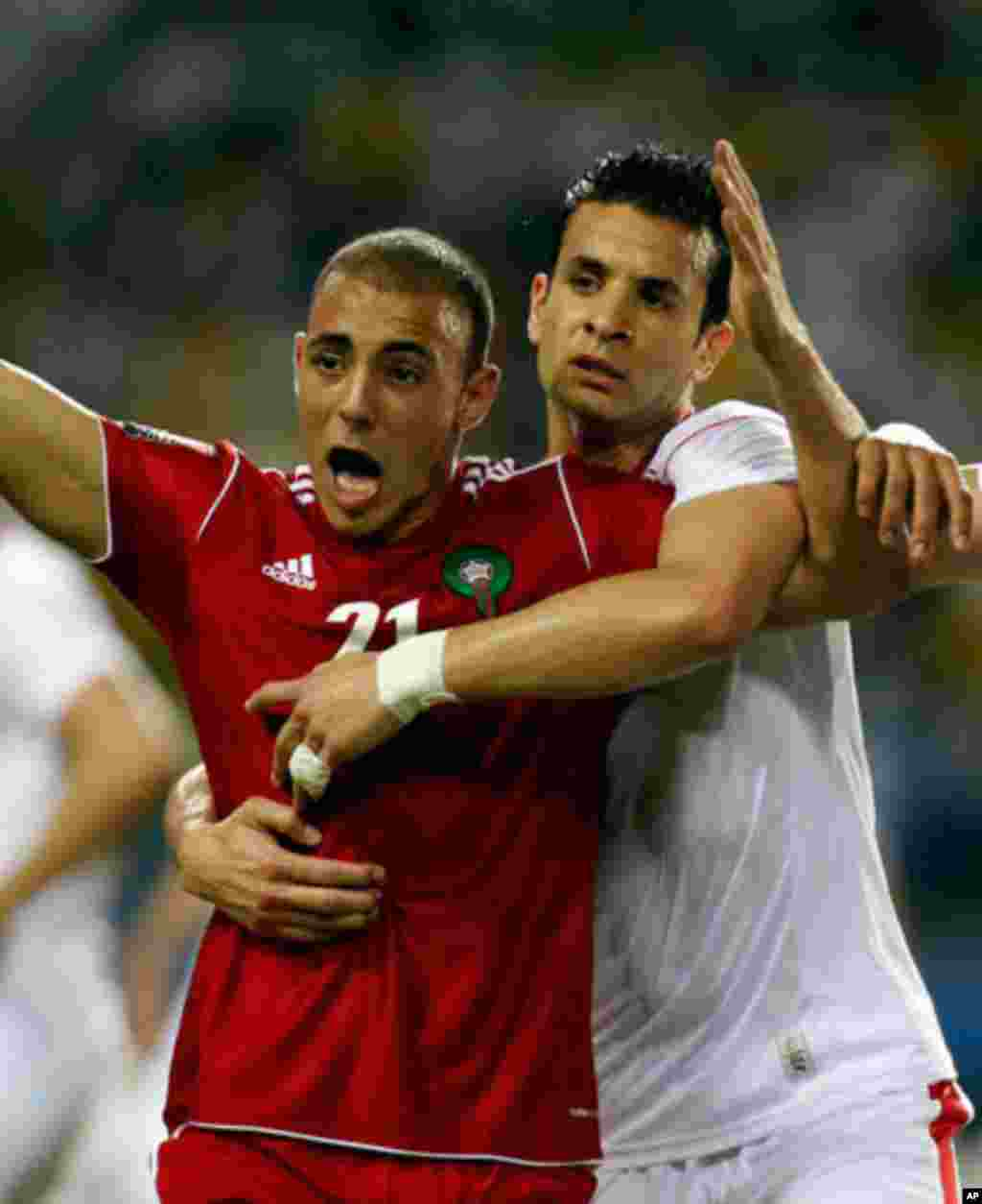 Morocco's Aissam appeals to the referee during their African Cup of Nations soccer match against Tunisia in Libreville