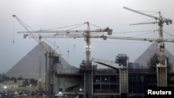 Construction is seen at the new museum in front of the Giza pyramids area, on the outskirts of Cairo, Egypt, May 18, 2015.