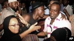 FILE - Mombasa County Governor elect Hassan Ali Joho, right, of the CORD party, is congratulated by some of his supporters after the IEBC declared him the winner to become the first Governor for Mombasa town, March 7, 2013.