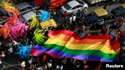 Participants holding a rainbow flag, promoting gay, lesbian, bisexual and transgender rights, in Mumbai. (File)