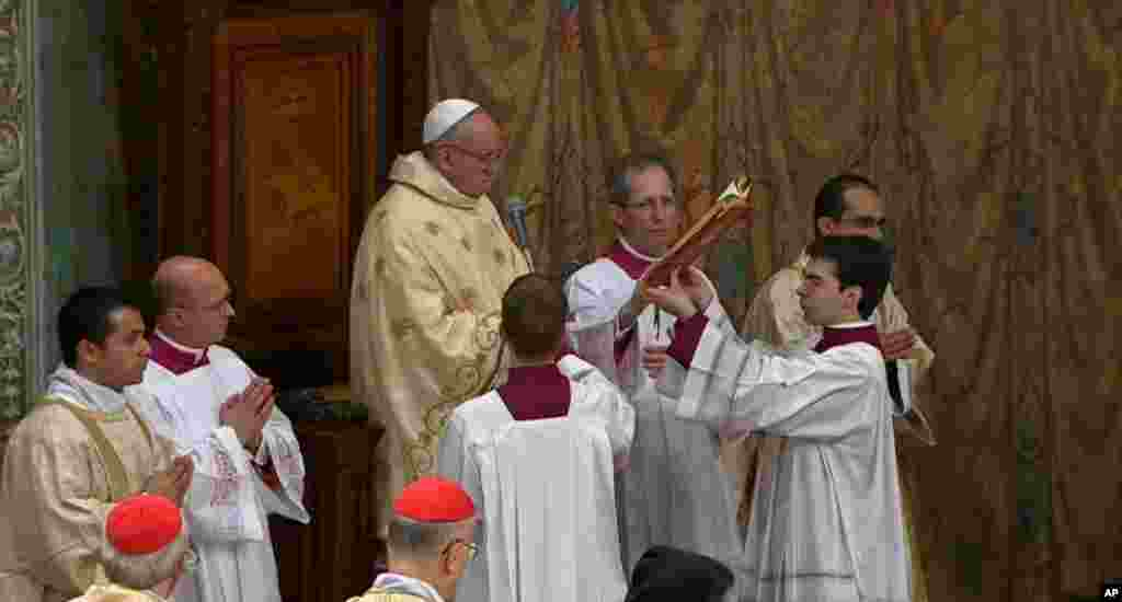 In this image made from video provided by CTV, Pope Francis celebrates his inaugural Mass with cardinals, inside the Sistine Chapel, at the Vatican, March 14, 2013.
