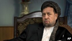 FILE - Deputy Afghan Chief Executive Mohammed Mohaqiq in his office in Kabul, Afghanistan, Oct. 27, 2013.