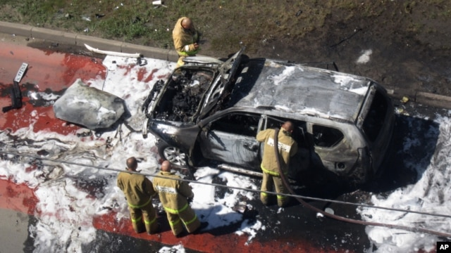 Emergency Situations Ministry rescuers examine a car of Tatarstan's chief mufti Ildus Faizov after a bomb attack in Kazan, about 700 kilometers (450 miles) east of Moscow, central Russia, July 19, 2012.