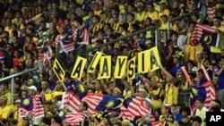 فٹبال میں متنازعہ فتح پر ملائیشیا میں جشن، عام تعطیل