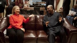 U.S. Secretary of State Hillary Rodham Clinton, left, meets with Ghana's President John Dramani Mahama, at his residence in Accra, Ghana, Aug. 9, 2012.