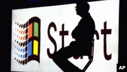 FILE - In this Aug. 24, 1995 file photo, Microsoft Chairman Bill Gates sits on stage during a video portion of the Windows 95 Launch Event on the company's campus in Redmond, Washington.
