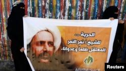 Shia ulamo Nimr al-Nimr suratini ko'targan namoyishchilar, 2014-yilda olingan surat